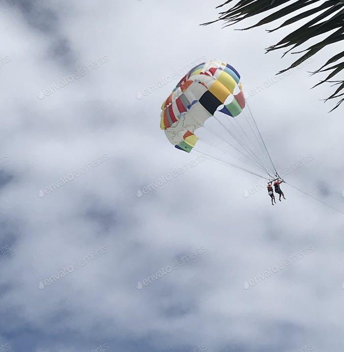 Couple parasailing in tropics