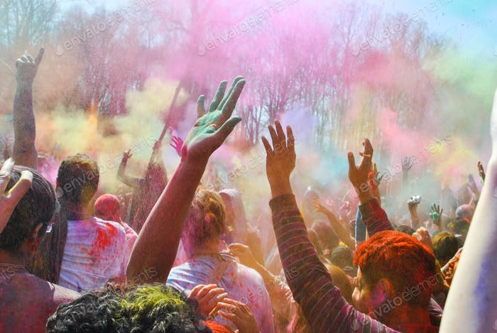 Holi festival of colors. Participants throw colors into the air.