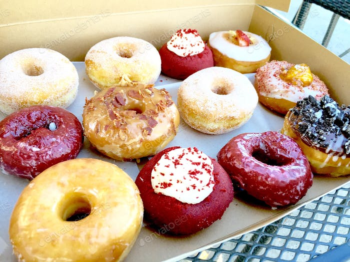 Box full of a dozen assorted gourmet donuts