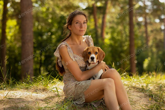dog training, millennial woman with beagle dog taking pictures in nature