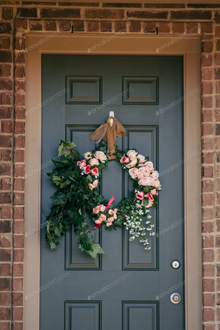 Front door with floral wreath for spring
