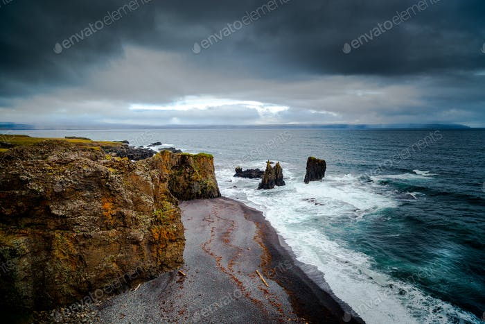 Stormy weather seascape in iceland cliffs