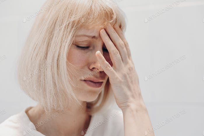 Portrait of a crying woman on a white background