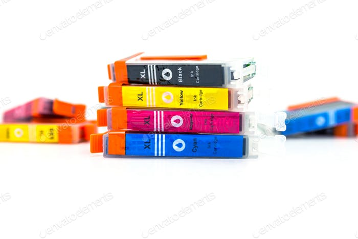 Close-up shot of a CMYK ink cartridges for a color printer isolated on a white background