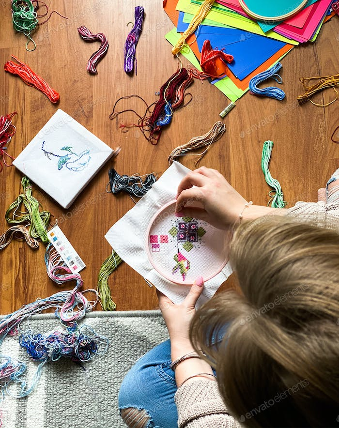 Stitching, crafting a picture of a humming bird as a hobby