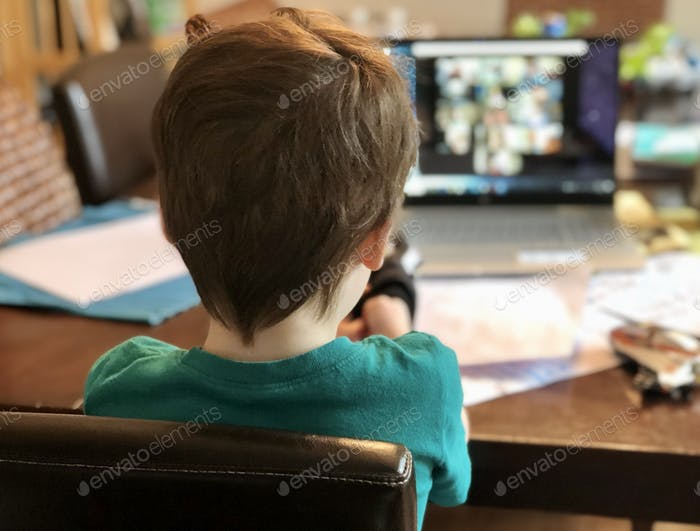 Kindergartener on zoom meeting with his class