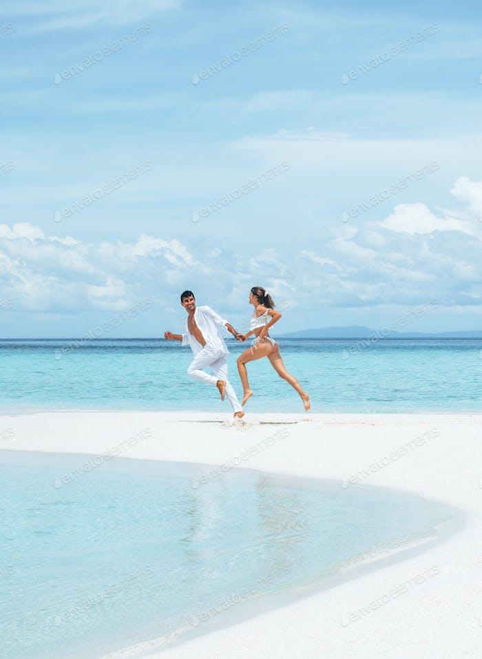 Couple Run on sand bar