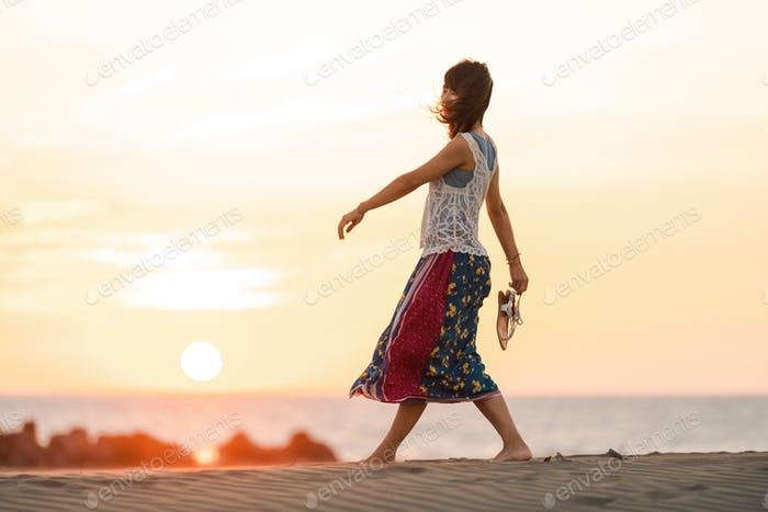 Girl walking on sand at the beach
