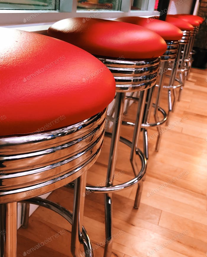 Red and chrome retro bar stools at a restaurant