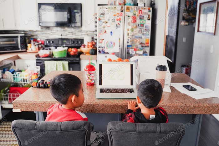 Young diverse boy with brother brothers  family work from home distance learning class lesson puzzle