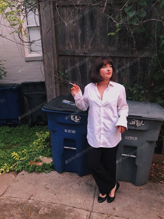A young woman dressed up as a movie character (Mia Wallace) for Halloween.
