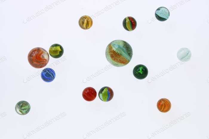 Marbles against white background