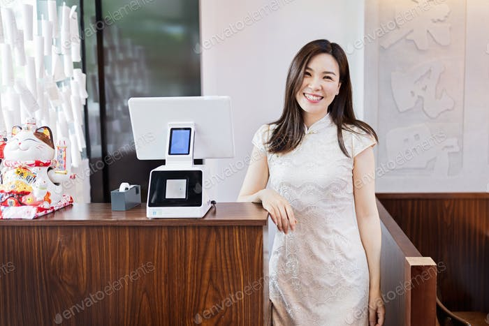 Small Business owner waiting customers in authentic asian cafeteria.