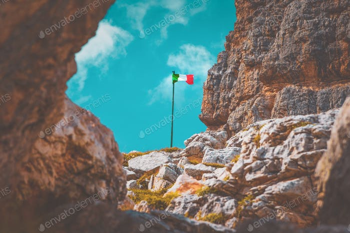 Italian flag flying its colors in the rocky mountains of the Dolomites. A landmark in a landmark!