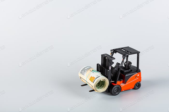Forklift with cash money on fork on gray background with copy space