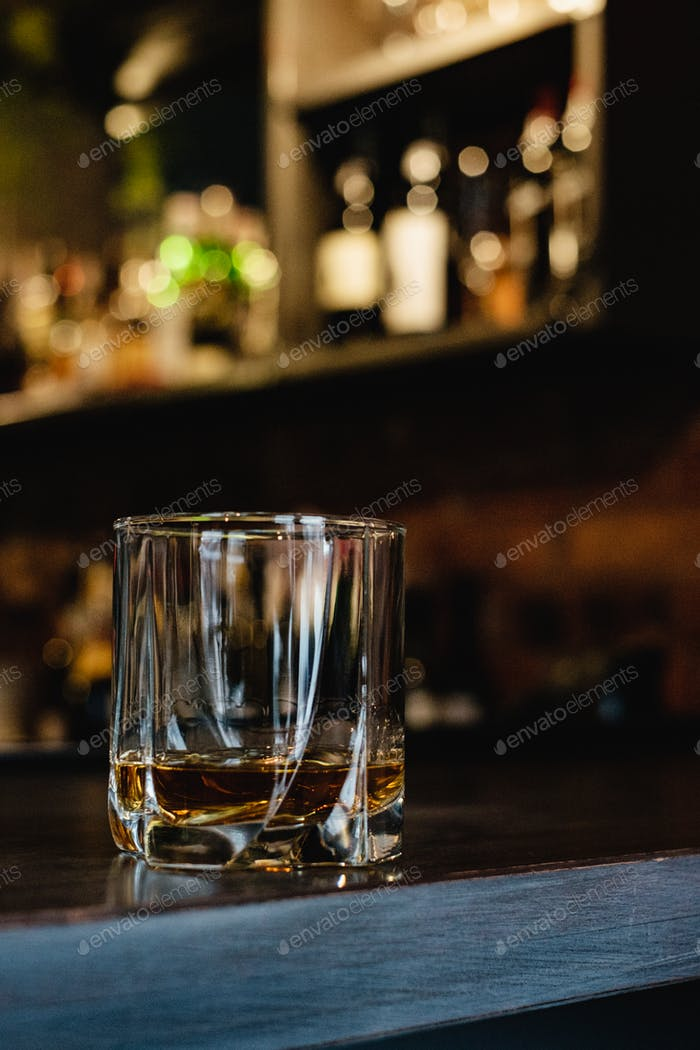 glass of whiskey on the bar top