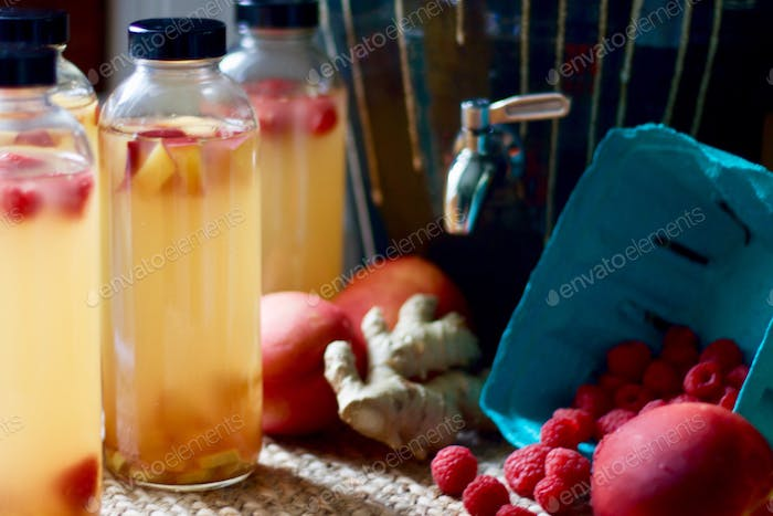 Kombucha, bottled for a second-ferment, flavored with fruit for flavoring