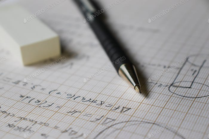 solving math problems in pencil on mm paper