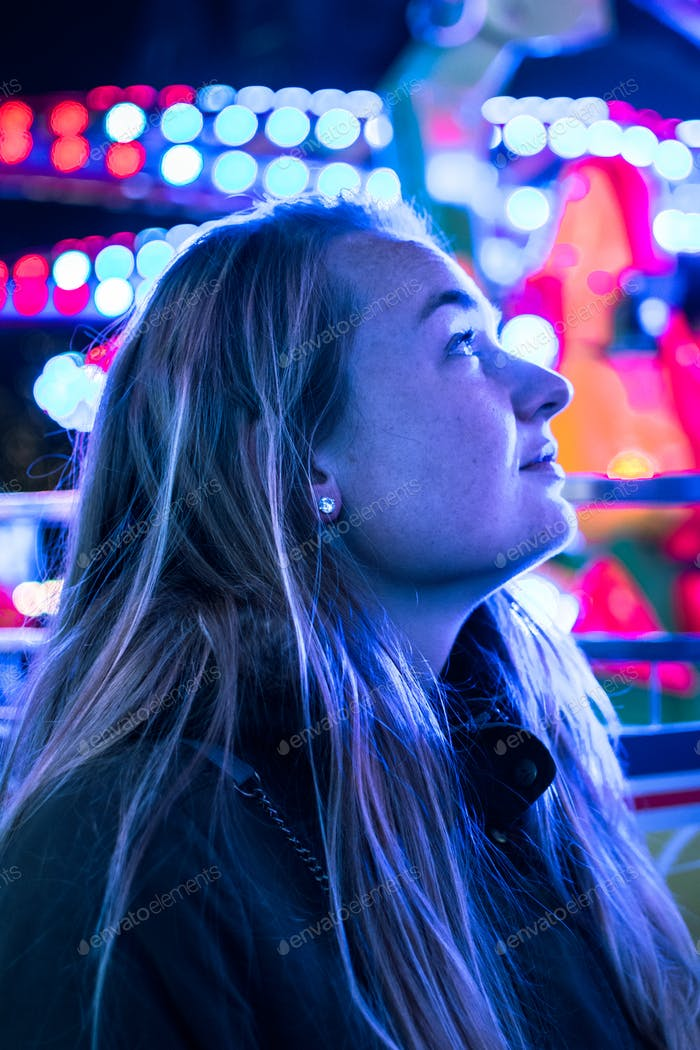 *Nominated* Portrait of a girl at the carnival with beautiful lighting on her face with nice bokeh