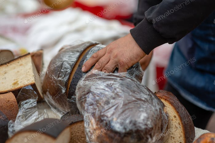 A baker with a knife cuts a big bribe