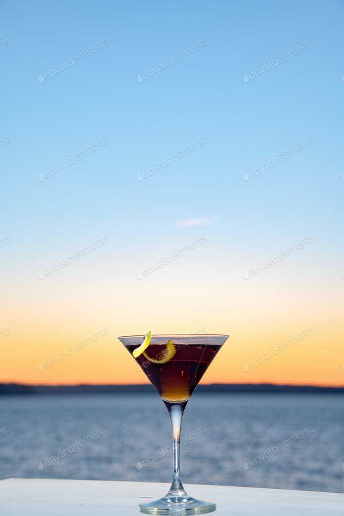 Mixed drink outside at sunset