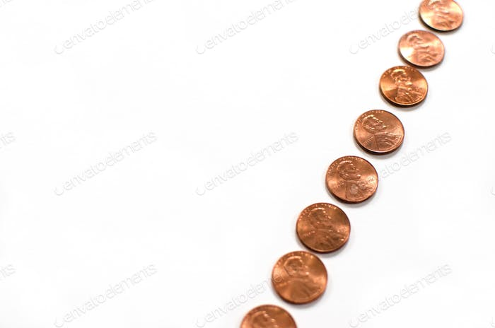 Diagonal line of pennies with negative space for copy