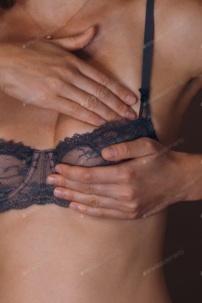 Woman giving self breast exam.