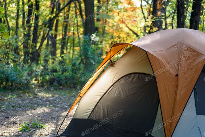 Morning sunlight on tent at campground in autumn