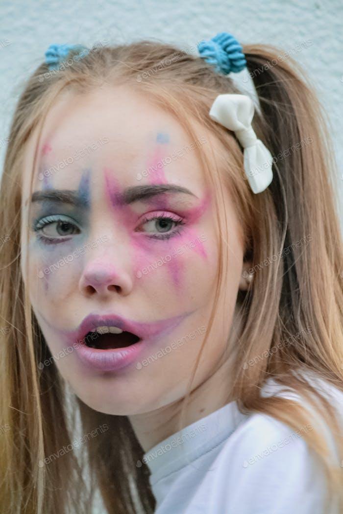 Girl in a clown makeup