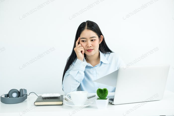 Working Asian women feel stressed, dismal tired from work, migraine headaches from hard work while