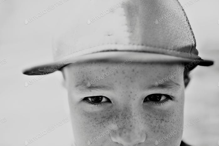 little boy looking into the camera with freckles