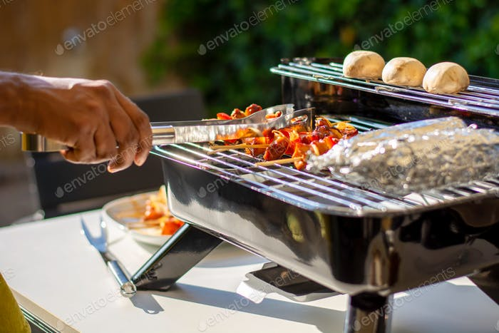 Grilling on a hybrid grill barbecue for electric or charcoal.