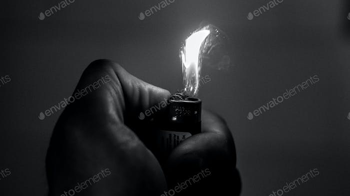 Lighting a lighter