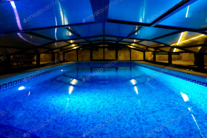 Indoor swimming pool. Night photography. Standing water.
