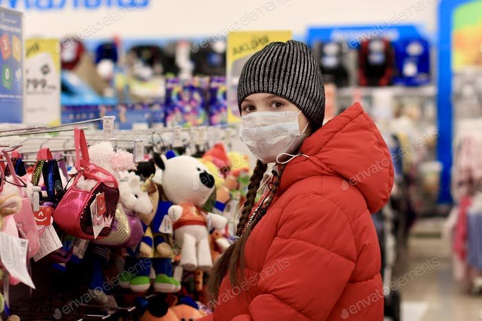 teenage girl shopping, wearing protective mask against Coronavirus in public places, store, market.