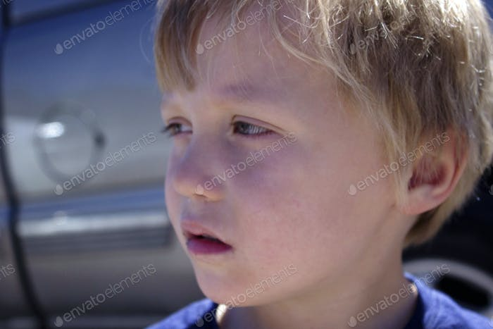 Pensive / emotional little boy