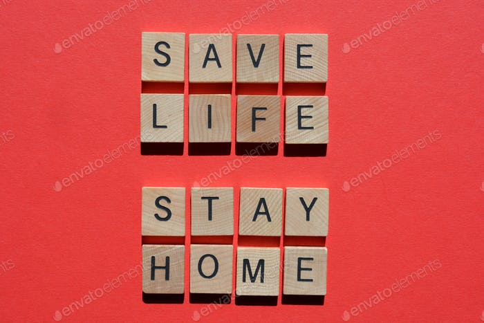 Save Life, Stay Home, words in 3D wood alphabet letters on red