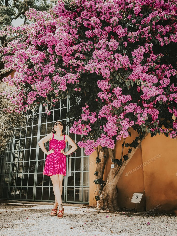 Beautiful woman near blooming tree