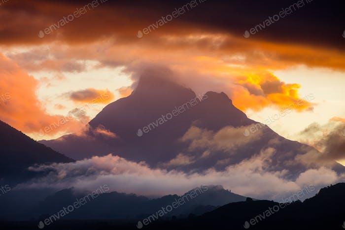 Sunset erupts around Mount Visoke, an active volcano in Congo