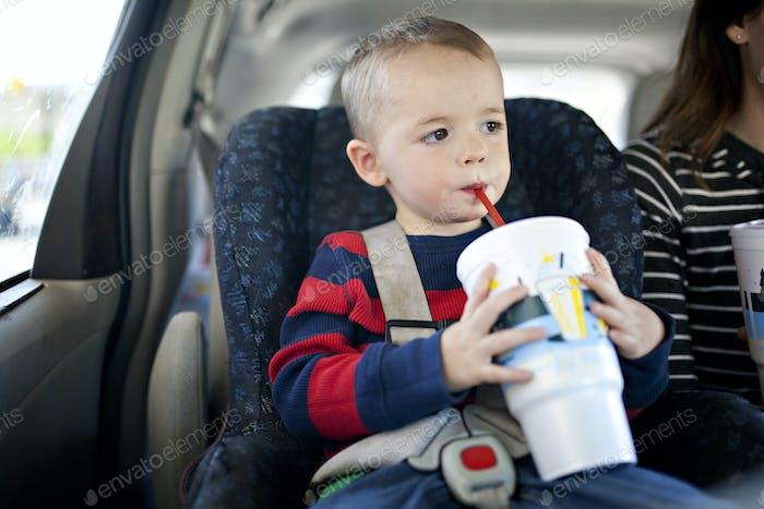 Boy drinking a soda