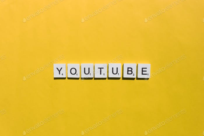 YouTube scrabble letters word on a yellow background
