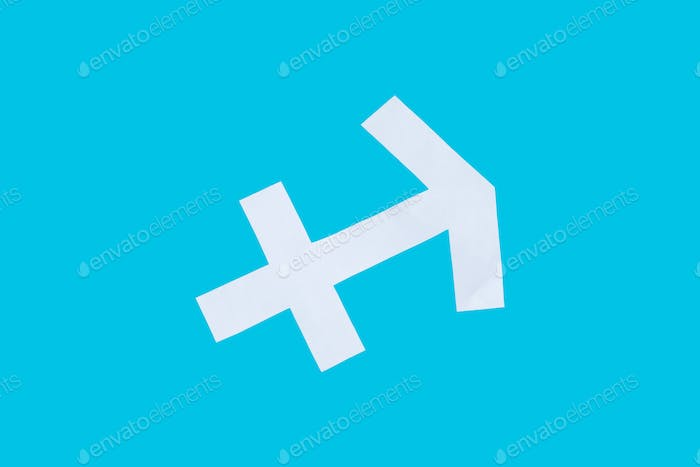 paper cut horoscope sign Sagittarius isolated on a blue background
