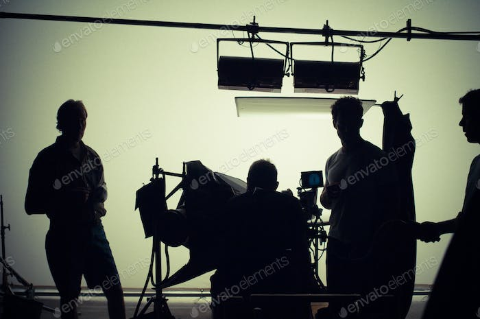 lighting crew on stage shooting a movie - filming