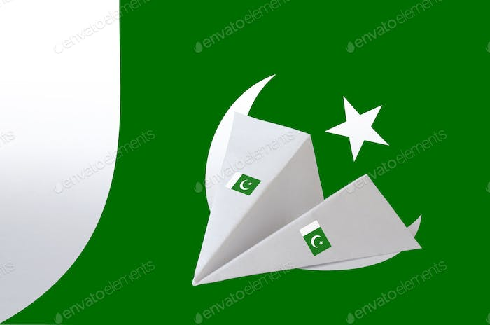 Pakistan flag depicted on paper origami airplane. Oriental handmade arts concept