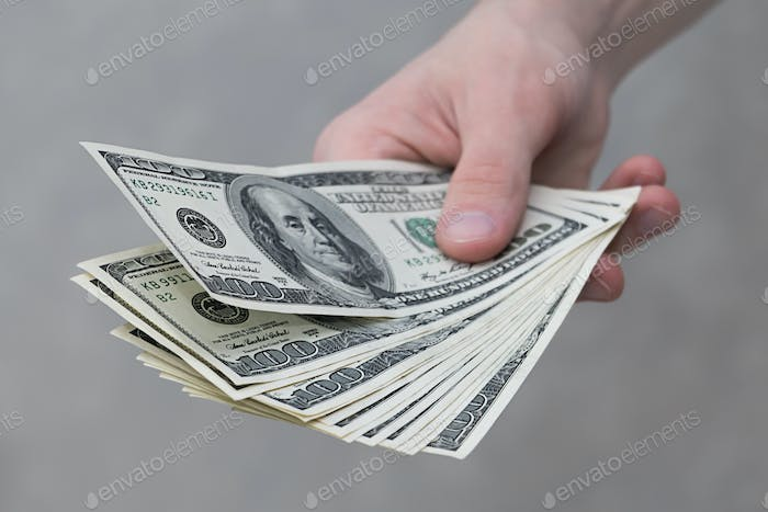 dollars in hand