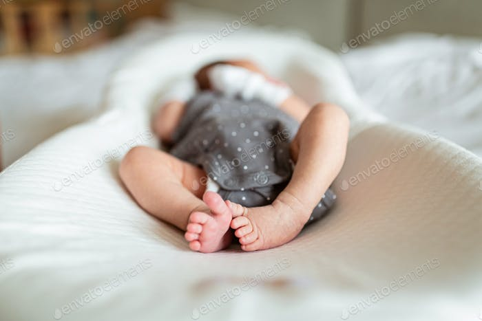 Newborn Baby in white cocoon. health care, hygiene, happy family concept