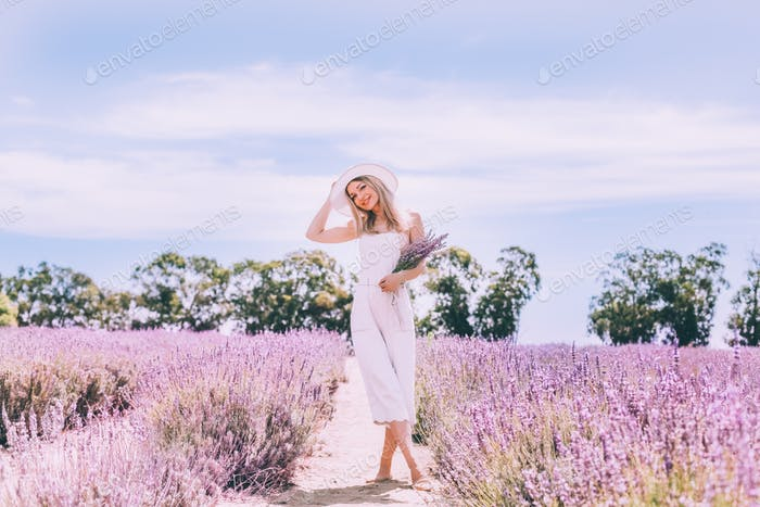 Lavender field and beautiful young girl
