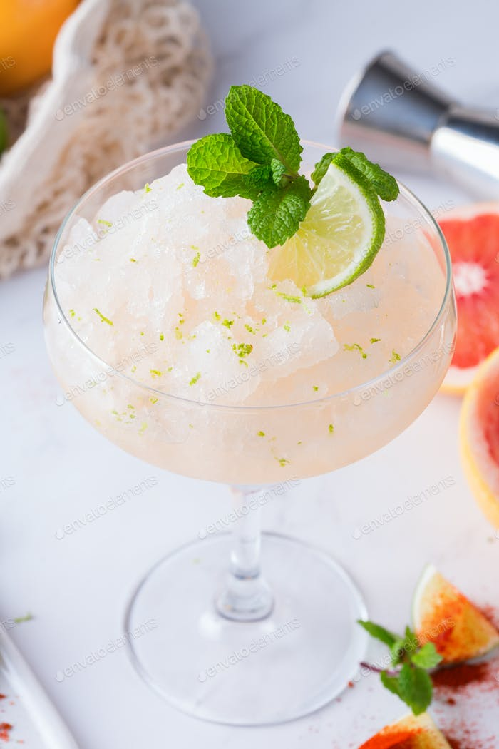 Frozen Mezcal or mescal Margarita cocktail with grapefruit and lime