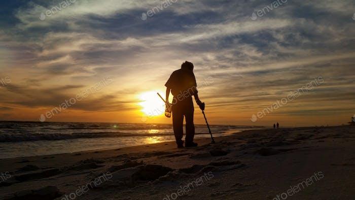 Treasure seeker on the beach...