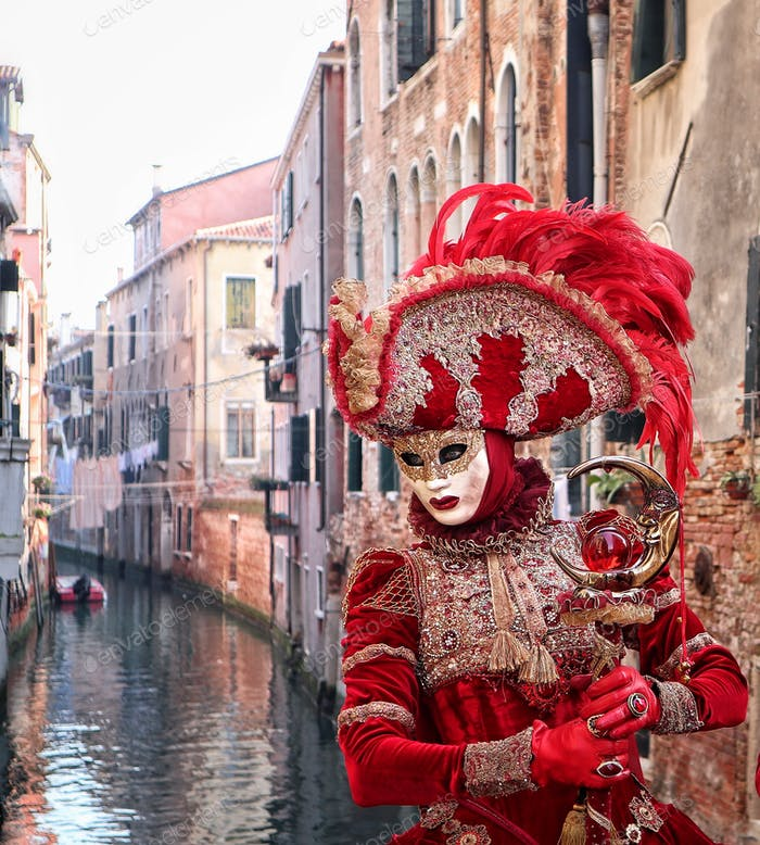 Tipycal venetian mask on canal background